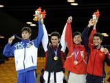 Gold medalist Kaveh Rezaei of Iran (2nd L), silver medalist Nursultan Maymayev of Kazakstan (1st L), bronze medalists Quoc Cuong Nguyen of Vietnam (1st R) and Jia Jun Daryl Tan of Singapore stand on the podium during the awarding ceremony of the men's -55kg of taekwondo.