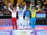 The silver medalist Aliaskhab Sirazhov of Russia, the gold medalist KIM Jin Hak of South Korea, the bronze medalists Michel Samaha of Lebanon and Maksym Dominishyn of Ukraine(L-R)