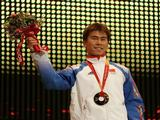 Xiaopeng Han of China celebrates his gold medal in the men's aerials during the Medals Ceremony on Day 14 of the Turin 2006 Winter Olympic Games on February 24, 2006 at the Medals Plaza in Turin, Italy.