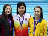 (Left to Right) Bronze medalist Lauren Earp of Canada, gold medalist Tang Yi of China and silver medalist Emma McKeon of Australia pose with their medals after the victory ceremony for the Youth Women's 100m Freestyle swimming final.