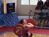 Weightlifter Kiana Elliot lifting at the 2014 Youth Olympic Games qualification event in New Caledonia where she sealed her spot at the YOG in Nanjing, China.