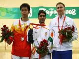 (L-R) Silver medalist Zhu Qinan of China, Gold medalist Abhinav Bindra of India and Bronze medalist Henri Hakkinen of Finland pose after the Men's 10m Air Rifle Final at the Beijing Shooting Range Hall.