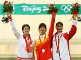 (L-R) Natalia Paderina of Russia, silver, Guo Wenjun of China, gold, and Nino Salukvadze of Georgia, bronze, celebrate after receiving their medals in the women's 10m air pistol final shooting event held at the Beijing Shooting Range Hall.