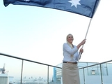 Basketballer Lauren Jackson waves the Australian flag after being announced as the Australian flag bearer at the Australian 2012 Olympic Games team flag bearer announcement at the Stratford Westfield Southern Lounge on July 26, 2012 in London, England.