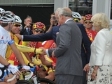 Cadel Evans (L) shakes hands with Prince Charles, Prince of Wales as Camilla, Duchess of Cornrwall looks on at the start of the cycling road race during the 2012 London Olympic games on July 28, 2012 in London, England.
