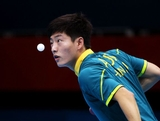 LONDON, ENGLAND - JULY 28:  Justin Han of Australia serves against Mawussi Agbetoglo of Togo during their Men's Singles Table Tennis match on day one of the London 2012 Olympic Games at ExCeL on July 28, 2012 in London, England.