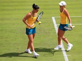 LONDON, ENGLAND - JULY 28:  Anastasia Rodionova and Jarmila Gajdosova of Australia compete in their Women's Doubles Tennis match during on Day 1 of the London 2012 Olympic Games at the All England Lawn Tennis and Croquet Club in Wimbledon on July 28, 2012 in London, England.