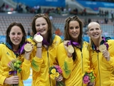 (L-R) Alicia Coutts, Melanie Schlanger, Brittany Elmslie and Cate Campbell celebrate with their gold medalis during the medal cermony for the Women's 4x100m Freestyle Relay on Day 1 of the London 2012 Olympic Games at the Aquatics Centre on July 28, 2012 in London, England.