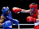 Ibrahim Balla (R) in action with Aboubakr Seddik Lbida of Morocco during their Men's Bantam weight (56kg) bout on Day 1 of the London 2012 Olympic Games at ExCeL on July 28, 2012 in London, England.
