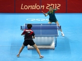 Miao Miao plays a forehand against Yi-Hua Huang of Chinese Taipei during their Women's Singles Table Tennis match on Day 1 of the London 2012 Olympic Games at ExCeL on July 28, 2012 in London, England.