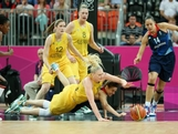 Natalie Stafford #4 of Great Britain and Lauren Jackson #15 of Australia dive for a loose ball in the second quarter during Women's Basketball on Day 1 of the London 2012 Olympic Games at the Basketball Arena on July 28, 2012 in London, England.