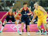 Stef Collins #6 of Great Britain dribbles against Samantha Richards #5 of Australia in the first half during Women's Basketball on Day 1 of the London 2012 Olympic Games at the Basketball Arena on July 28, 2012 in London, England.