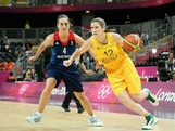 Belinda Snell #12 drives against Natalie Stafford #4 of Great Britain in the second quarter during Women's Basketball on Day 1 of the London 2012 Olympic Games at the Basketball Arena on July 28, 2012 in London, England.