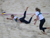 Nat Cook (L) and Tamsin Hinchley in action against the United States during the Women's Beach Volleyball Preliminary Round on Day 1 of the London 2012 Olympic Games at Horse Guards Parade on July 28, 2012 in London, England.