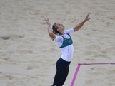 Tamsin Hinchley serves against the United States during the Women's Beach Volleyball Preliminary Round on Day 1 of the London 2012 Olympic Games at Horse Guards Parade on July 28, 2012 in London, England.