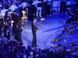 Young athletes about to light the cauldron during the Opening Ceremony of the London 2012 Olympic Games at the Olympic Stadium on July 27, 2012.
