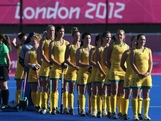 The Australia players line up prior to the Women's Pool WB Match W01 between New Zealand and Australia at the Hockey Centre on July 29, 2012 in London, England.