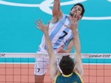 Facundo Conte #7 of Argentina spikes the ball as Travis Passier #5 of Australia defends during Men's Volleyball on Day 2 of the London 2012 Olympic Games at Earls Court on July 29, 2012 in London, England.