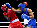 Jeffrey Horn of Australia (R) in action with Gilbert Choombe of Zambia during their Men's Light Welter (64kg) Boxing bout on day 2 of the London 2012 Olympic Games at ExCeL on July 29, 2012 in London, England.