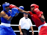 Jeffrey Horn of Australia (L) in action with Gilbert Choombe of Zambia during their Men's Light Welter (64kg) Boxing bout on day 2 of the London 2012 Olympic Games at ExCeL on July 29, 2012 in London, England.