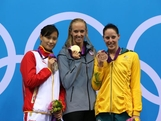 Silver medallist Ying Lu of China, gold medallist Dana Vollmer of the United States and bronze medallist Alicia Coutts pose on the podium during the medal ceremony on Day 2 of the London 2012 Olympic Games at the Aquatics Centre on July 29, 2012 in London, England.
