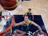 Australia's Brad Newley grabs the rim as he tries to score against Brazil during the first half of a preliminary men's basketball game on Day 2 of the London 2012 Olympic Games at the Basketball Arena on July 29, 2012 in London, England.