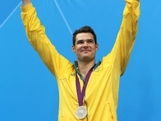 Silver medallist Christian Sprenger of Australia poses on the podium during the medal ceremony following the Men's 100m Breastsroke final on Day 2 of the London 2012 Olympic Games at the Aquatics Centre on July 29, 2012 in London, England.