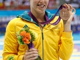 Bronze medallist Alicia Coutts of Australia poses with the gold medal won  in  Womens 100m Butterfly final during the medal ceremony on Day 2 of the London 2012 Olympic Games at the Aquatics Centre on July 29, 2012 in London, England.