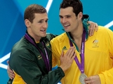 (L-R) Gold medallist Cameron van der Burgh of South Africa  is hugged by Silver medallist Christian Sprengerduring the medal ceremony following the Men's 100m Breastsroke final on Day 2 of the London 2012 Olympic Games at the Aquatics Centre on July 29, 2012 in London, England.