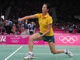 Victoria Na of Australia hits a return against Monika Fasungova of Slovakia during their Women's Singles Group D Badminton match on Day 3 of the London 2012 Olympic Games at Wembley Arena on July 30, 2012 in London, England.