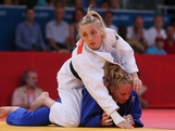 LONDON, ENGLAND - JULY 30:  Automne Pavia of France (white) competes with Carli Renzi of Australia in the Women's -52 kg Judo on Day 3 of the London 2012 Olympic Games at ExCeL on July 30, 2012 in London, England.