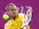 Lleyton Hewitt of Australia plays a backhand during the Men's Singles Tennis match against Sergiy Stakhovsky of Ukraine on Day 3 of the London 2012 Olympic Games at the All England Lawn Tennis and Croquet Club in Wimbledon on July 30, 2012 in London, England.