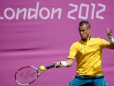 Lleyton Hewitt of Australia plays a forehand during the Men's Singles Tennis match against Sergiy Stakhovsky of Ukraine on Day 3 of the London 2012 Olympic Games at the All England Lawn Tennis and Croquet Club in Wimbledon on July 30, 2012 in London, England.