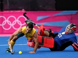 LONDON, ENGLAND - JULY 30:  Jamie Dwyer of Australia fights for the ball against Erasmus Pieterse of South Africa Men's Hockey on Day 3 at the Riverbank Arena on July 30, 2012 in London, England.