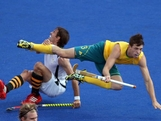 Simon Orchard of Australia fights for the ball against Thorton McDade of South Africa Men's Hockey on Day 3 at the Riverbank Arena on July 30, 2012 in London, England.