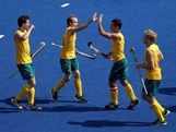 Team Australia celebrates after a goal against South Africa during their Men's Hockey match on Day 3 at the Riverbank Arena on July 30, 2012 in London, England.