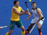 Russell Ford of Australia fights for the ball against Andrew Cronje of South Africa Men's Hockey on Day 3 at the Riverbank Arena on July 30, 2012 in London, England.