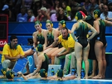 LONDON, ENGLAND - JULY 30:  Australia players are given instructions during the Women's Water Polo Preliminary match between Italy and Australia on Day 3 of the London 2012 Olympic Games  at Water Polo Arena on July 30, 2012 in London, England.