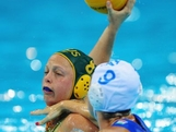 Kate Gynther of Australia is challenged by Giulia Enrica Emmolo of Italy during the Women's Water Polo Preliminary match between Italy and Australia on Day 3 of the London 2012 Olympic Games  at Water Polo Arena on July 30, 2012 in London, England.