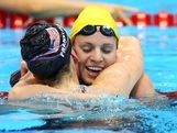 Emily Seebohm (R) congratulates Missy Franklin of the United States after Franklin won the Final of the Women's 100m Backstroke on Day 3 of the London 2012 Olympic Games at the Aquatics Centre on July 30, 2012 in London, England.
