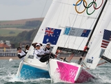 Olivia Price, Nina Curtis and Lucinda Whitty compete against Anna Tunnicliffe, Debbie Capozzi and Molly O'Bryan Vandemoer of the United States in the Women's Elliott 6m WMR Sailing on Day 3 of the London 2012 Olympic Games at Weymouth Harbour on July 30, 2012 in Weymouth, England.