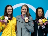 (L-R) Silver medalist Emily Seebohm of Australia, gold medalist Missy Franklin of the United States and bronze medalist Aya Terakawa of Japan celebrate with their medals during the medal ceremony for the Women's 100m Backstroke on Day 3 of the London 2012 Olympic Games at the Aquatics Centre on July 30, 2012 in London, England.