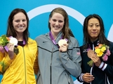 (L-R) Silver medalist Emily Seebohm, gold medalist Missy Franklin of the UNited States and bronze medalist Aya Terakawa of Japan celebrate with their medals during the medal ceremony for the Women's 100m Backstroke on Day 3 of the London 2012 Olympic Games at the Aquatics Centre on July 30, 2012 in London, England.