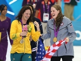 (L-R) Silver medalist Emily Seebohm of Australia and gold medalist Missy Franklin of the UNited States celebrate with their medals during the medal ceremony for the Women's 100m Backstroke on Day 3 of the London 2012 Olympic Games at the Aquatics Centre on July 30, 2012 in London, England.