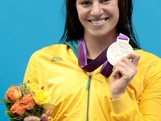 Silver medalist Emily Seebohm of Australia celebrates with her medal during the medal ceremony for the Women's 100m Backstroke on Day 3 of the London 2012 Olympic Games at the Aquatics Centre on July 30, 2012 in London, England.
