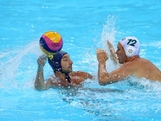 Billy Miller #12 of Australia attempts to block a pass from Yevgeniy Zhilyayev #9 of Kazakhstan during their Men's Water Polo preliminary round Group A match on Day 4 of the London 2012 Olympic Games at Water Polo Arena on July 31, 2012 in London, England.