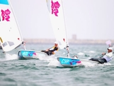 Pavlos Kontides (R) of Cyprus and Tom Slingsby of Australia compete in the Men's Laser Sailing on Day 4 of the London 2012 Olympic Games at Weymouth Harbour on July 31, 2012 in Weymouth, England.
