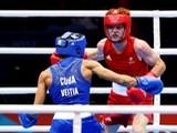 Billy Ward of Australia (R) in action with Yosbany Veita Soto of Cuba during the Men's Light Fly (46-49kg) Boxing on Day 4 of the London 2012 Olympic Games at ExCeL on July 31, 2012 in London, England.
