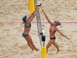 Louise Bawden of Australia and Sophie van Gestel of the Netherlands  compete during the Women's Beach Volleyball Preliminary match between Australia and the Netherlands on Day 4 at Horse Guards Parade on July 31, 2012 in London, England.