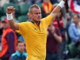 Lleyton Hewitt of Australia celebrates defeating Marin Cilic of Croatia in the second round of Men's Singles Tennis on Day 4 of the London 2012 Olympic Games at Wimbledon on July 31, 2012 in London, England.